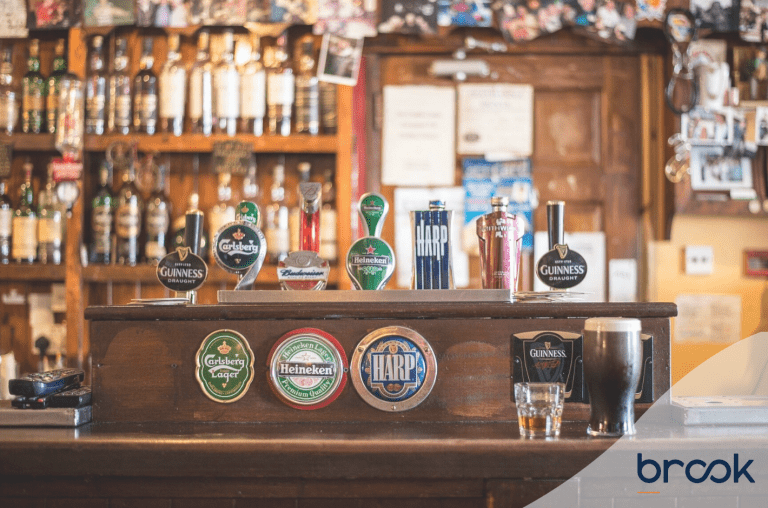 A photo of a bar and beer taps