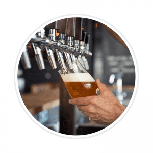 A picture of a bartender pouring a beer from a tap