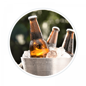 A picture of beer bottles in a bucket of ice